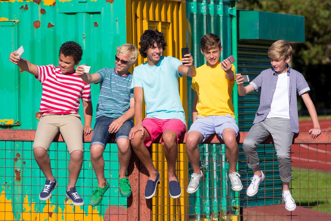 UK teenagers sat in park