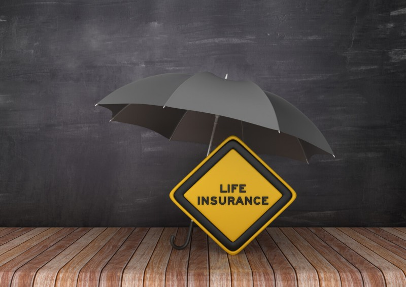 black umbrella over life insurnace sign