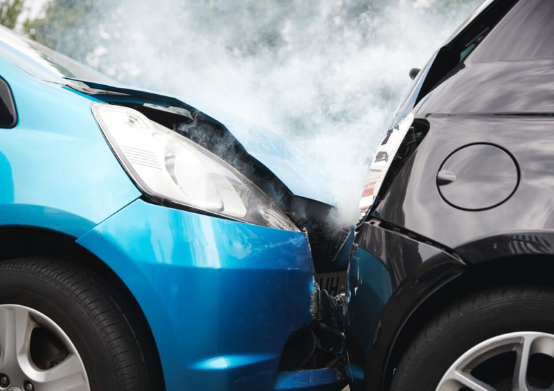 Blue car crashed into black car