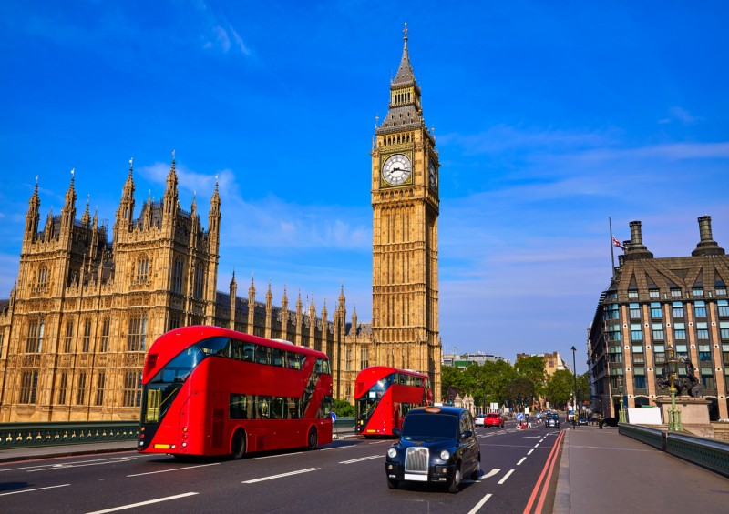 bus and black cab in london with big ben