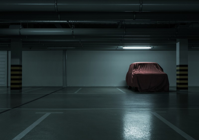car covered up parked in dark car park