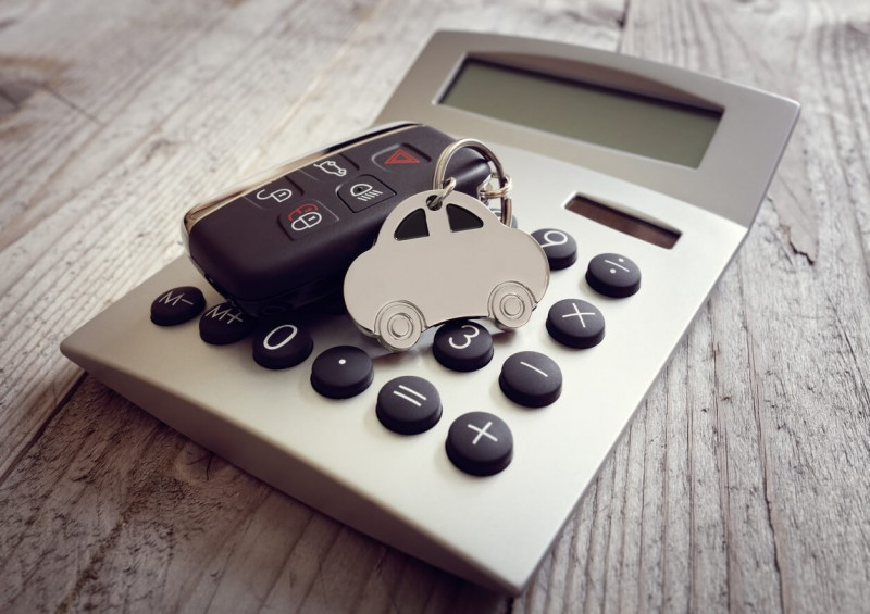 car keys and car key ring on top of calculator