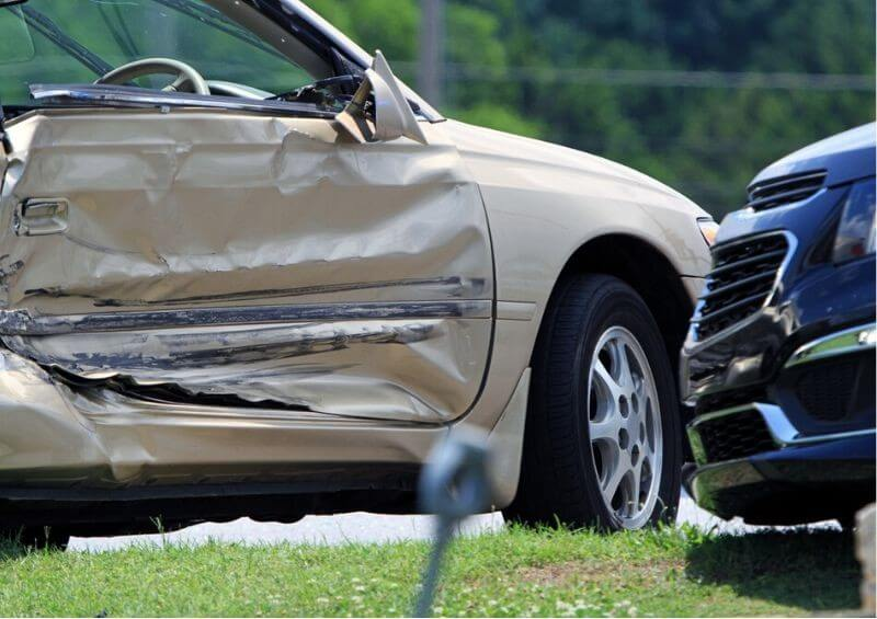 Car with damage on side after accident