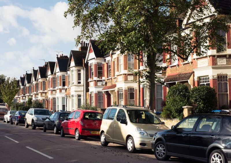 Cars parked outside houses