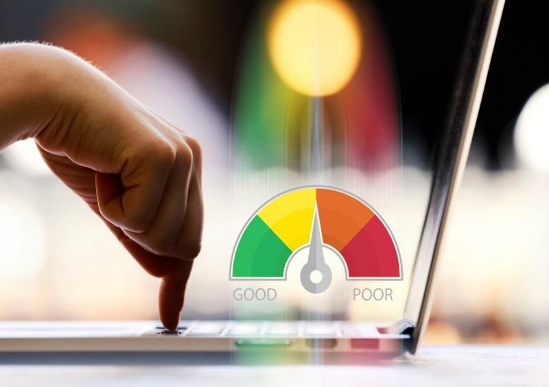 Credit score diagram next to laptop
