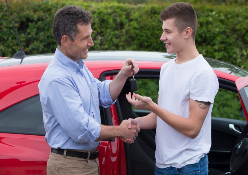dad giving son keys to the car