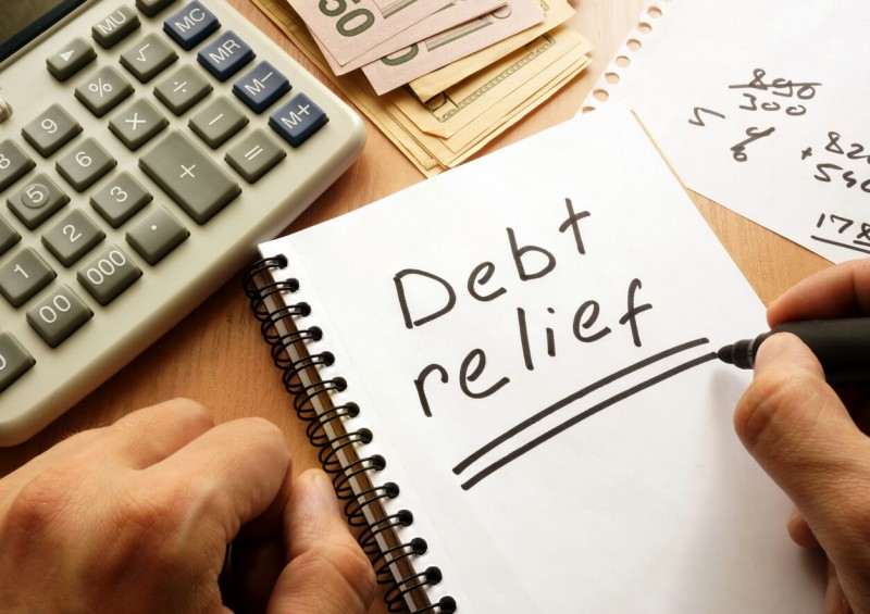 debt relief written on a notebook with marker