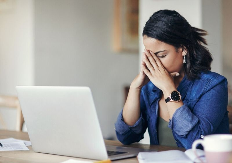 Distressed woman dealing with finances after death