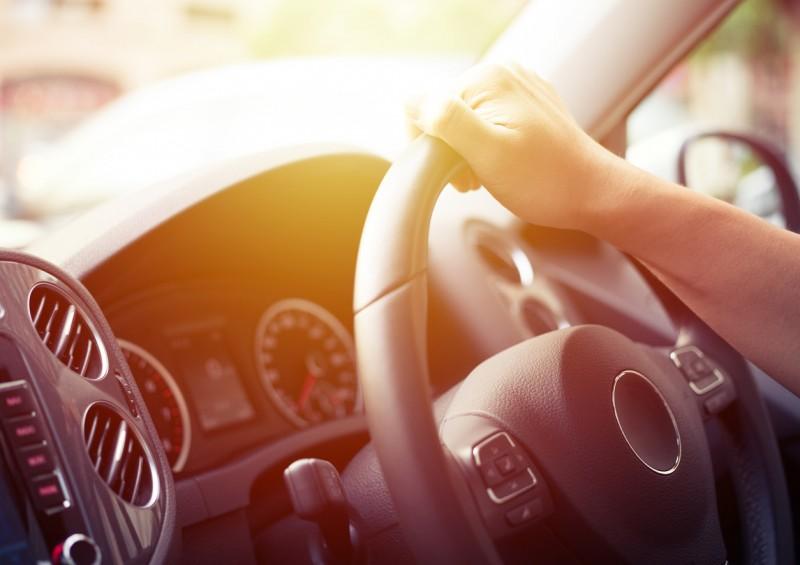 Driver s hand on steering wheel