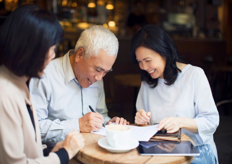 Elderly couple signing a Lasting Power of Attorney
