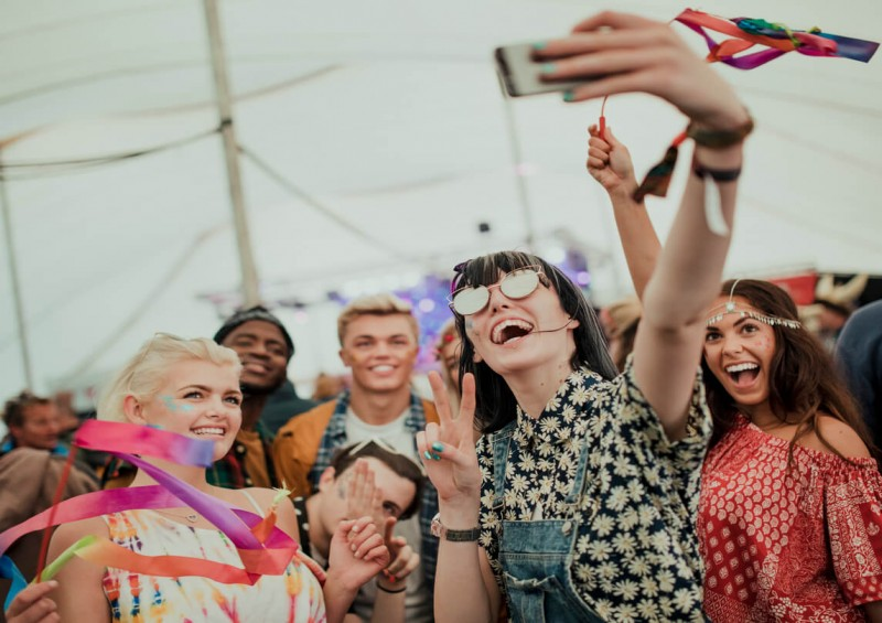 Friends taking a selfie at music festival