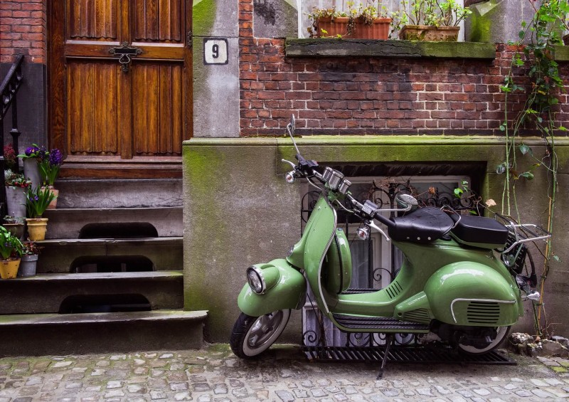 green moped outside hosue