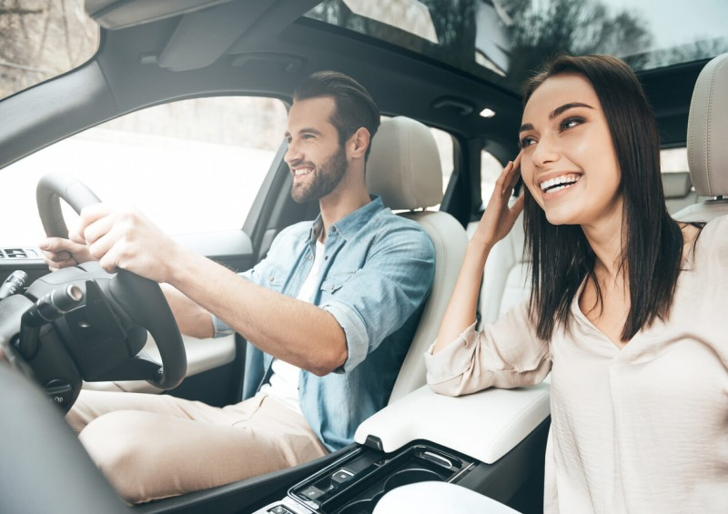 man and woman smiling in car