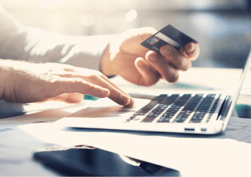 Man doing online banking on laptop