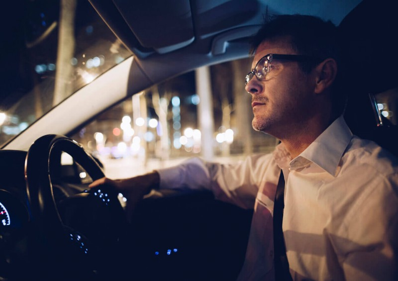 Man driving at night