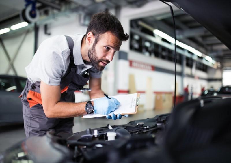 Man MOT testing a car at a garage