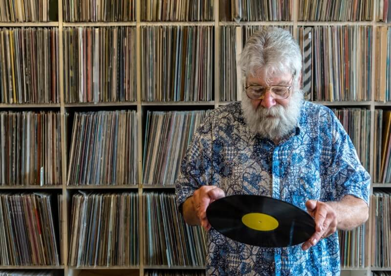man with old records