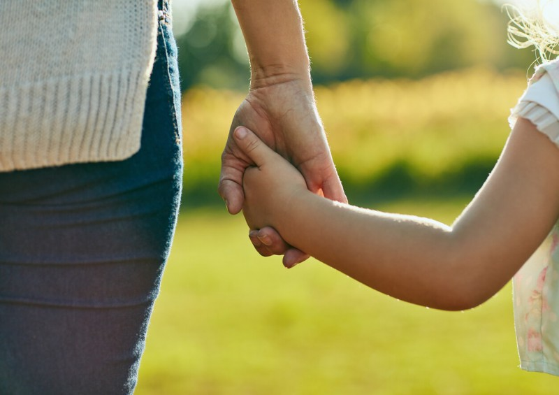 Mother holding daughter s hand