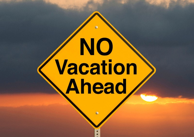 No vacation ahead sign yellow