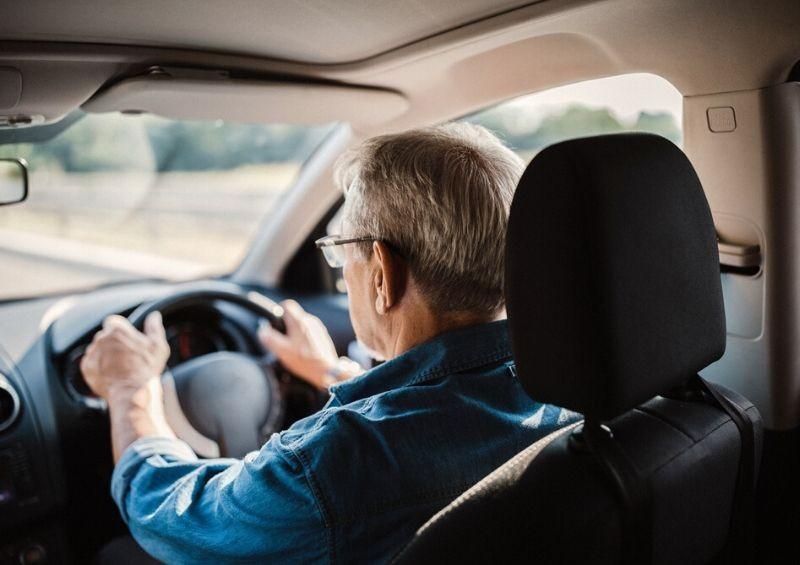 Older man driving car