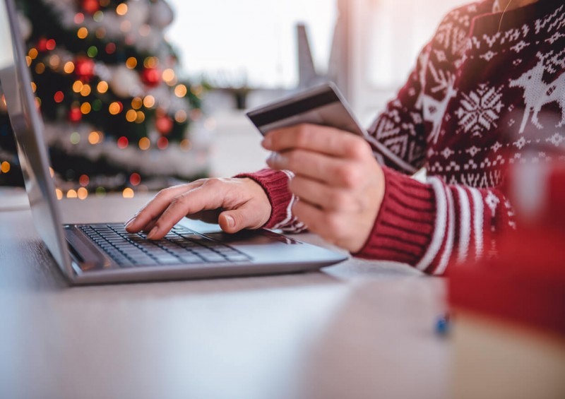 Person Christmas shopping with credit card
