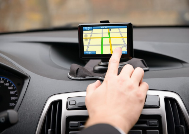 Person setting up Sat Nav in their car