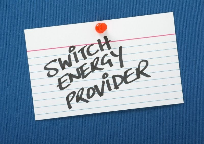 Piece of paper pinned to board with switch energy provider
