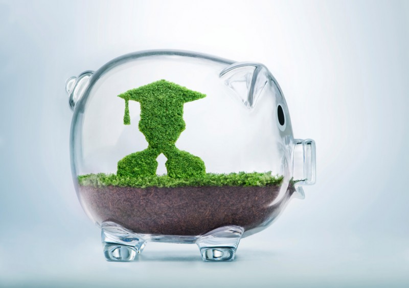 Piggy Bank with graduate or student inside