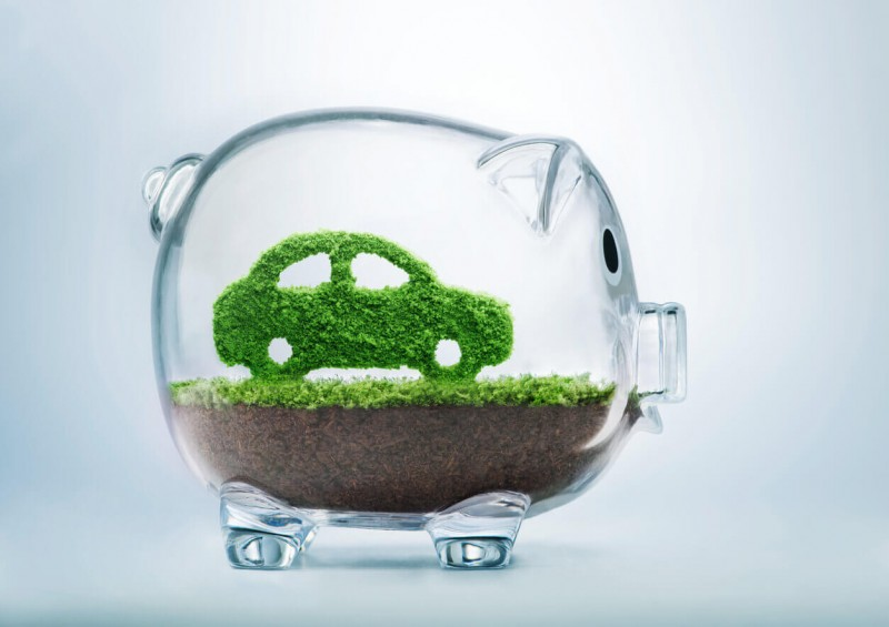 Piggy bank with green car inside