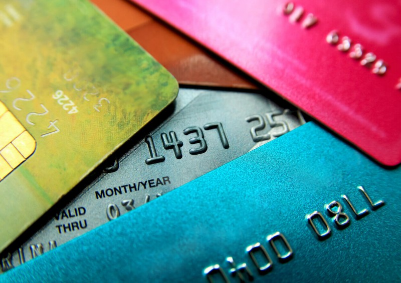 pink blue green and silver credit cards