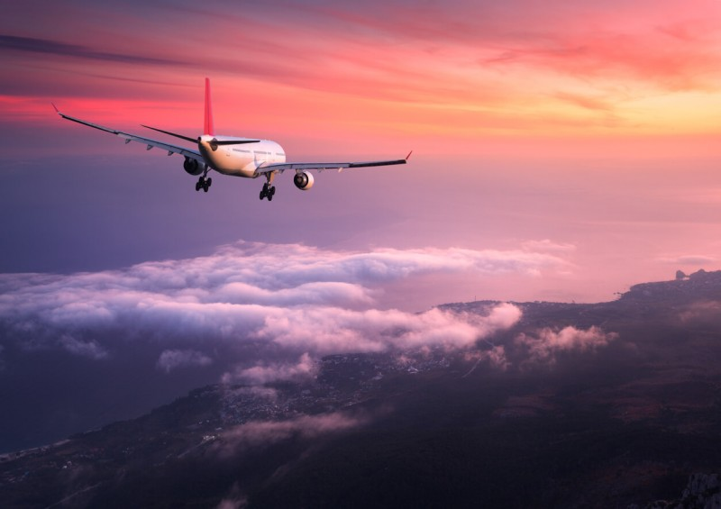 plane flying in the sunset