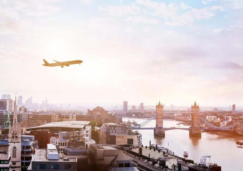plane flying over tower bridge in london