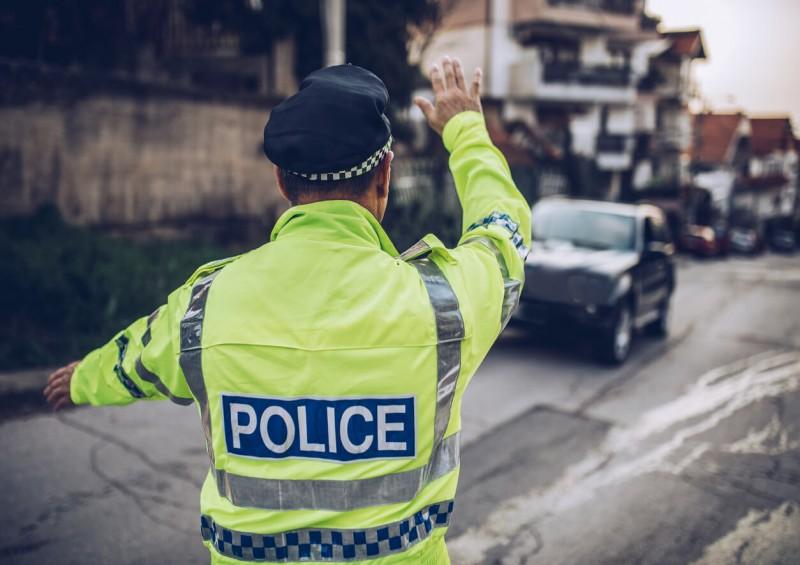 police officer pulling over car on uk road