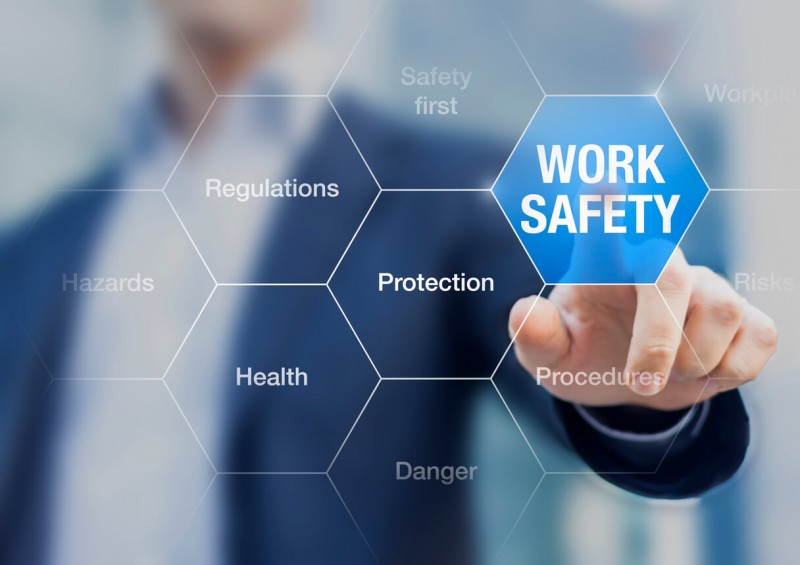 Screen with man pointing to work safety