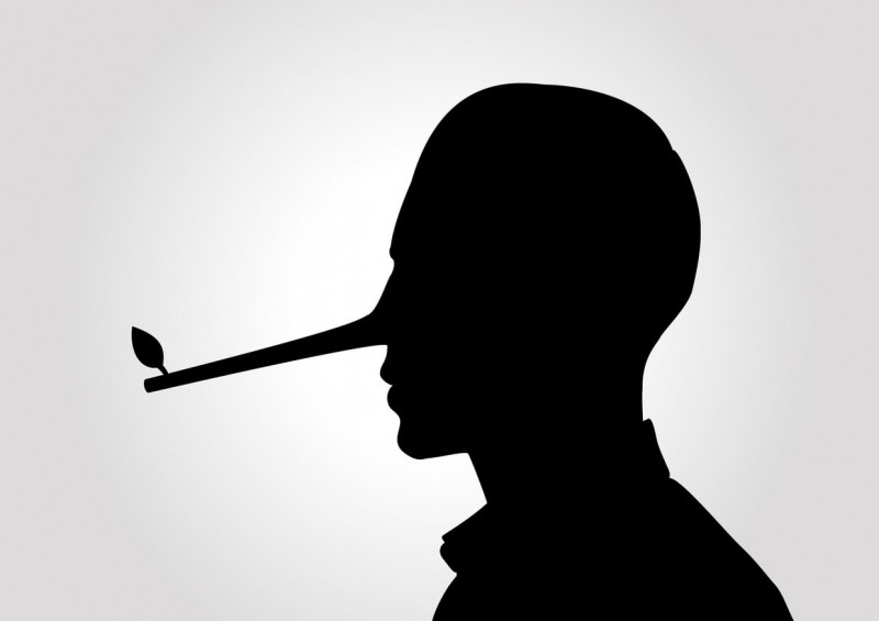 Silhouette of man with long pointy nose