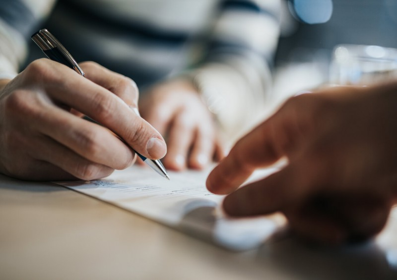 Someone signing trust contract