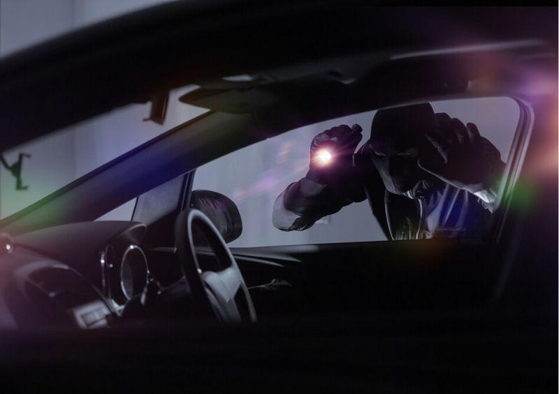 Thief looking through car window