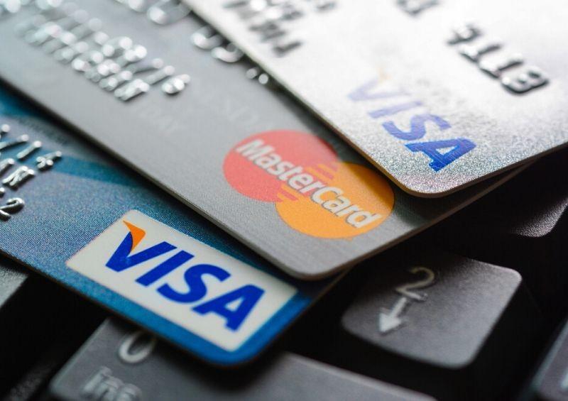 Three bank cards on keyboard