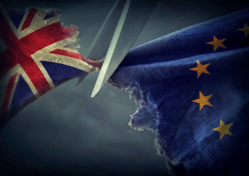 UK flag and EU flag being cut apart