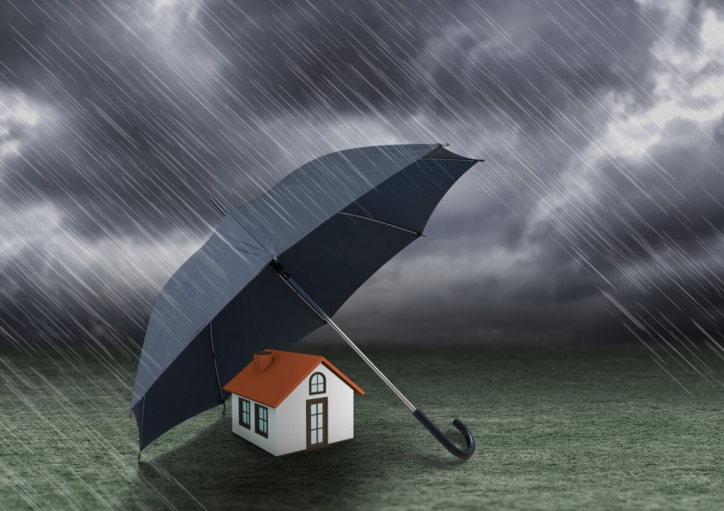 Umbrella protecting house from the rain