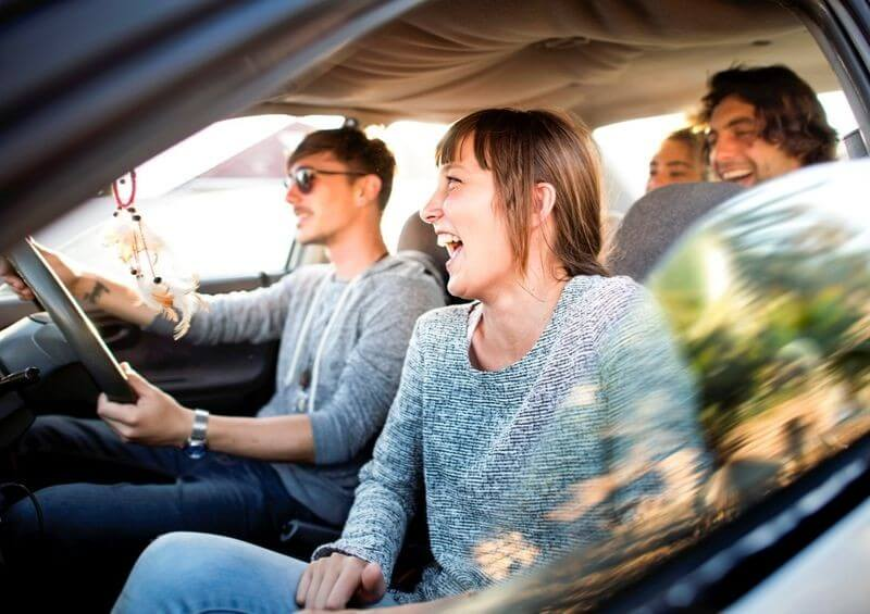 Young people laughing while driving