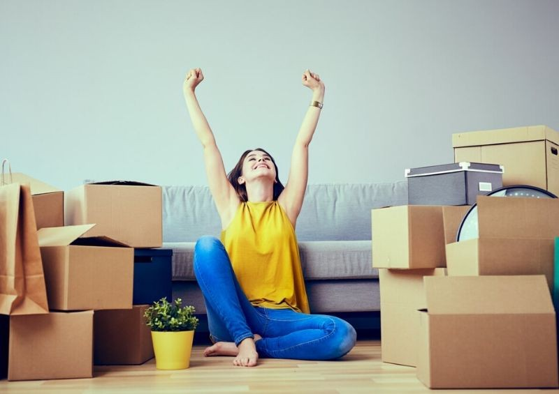 Young woman happy about moving into new home