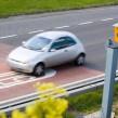 A car speeding past a speed camera