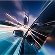 Car speeding at night passing lights