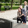 Children and mum visiting grave of their father