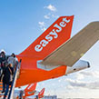 Easyjet customers boarding plane