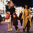 Family of four shopping at Christmas time