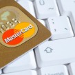 Gold MasterCard on computer keyboard