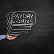 Payday loans written on white board